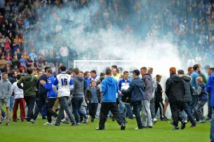 Upset fans invade the pitch after the final whistle and relegation is confirmed. Image courtesy of Liverpool Echo